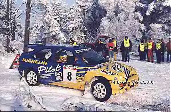 Malcolm Wilson's Group A Escort Cosworth on a snowy RAC/Network Q
