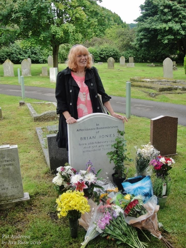 Pat Andrews, mother of Brian's son Mark, at his grave with ...