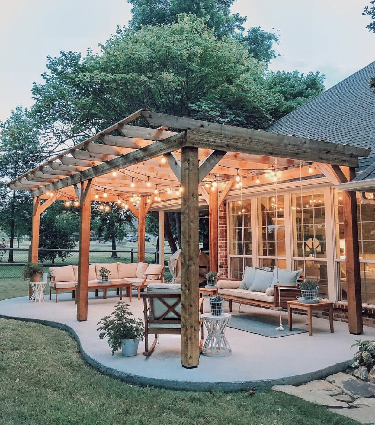 Would like to have some kind of covering over the back patio. Possibly wood if other wood accents are incorporated but otherwise white would be nice too