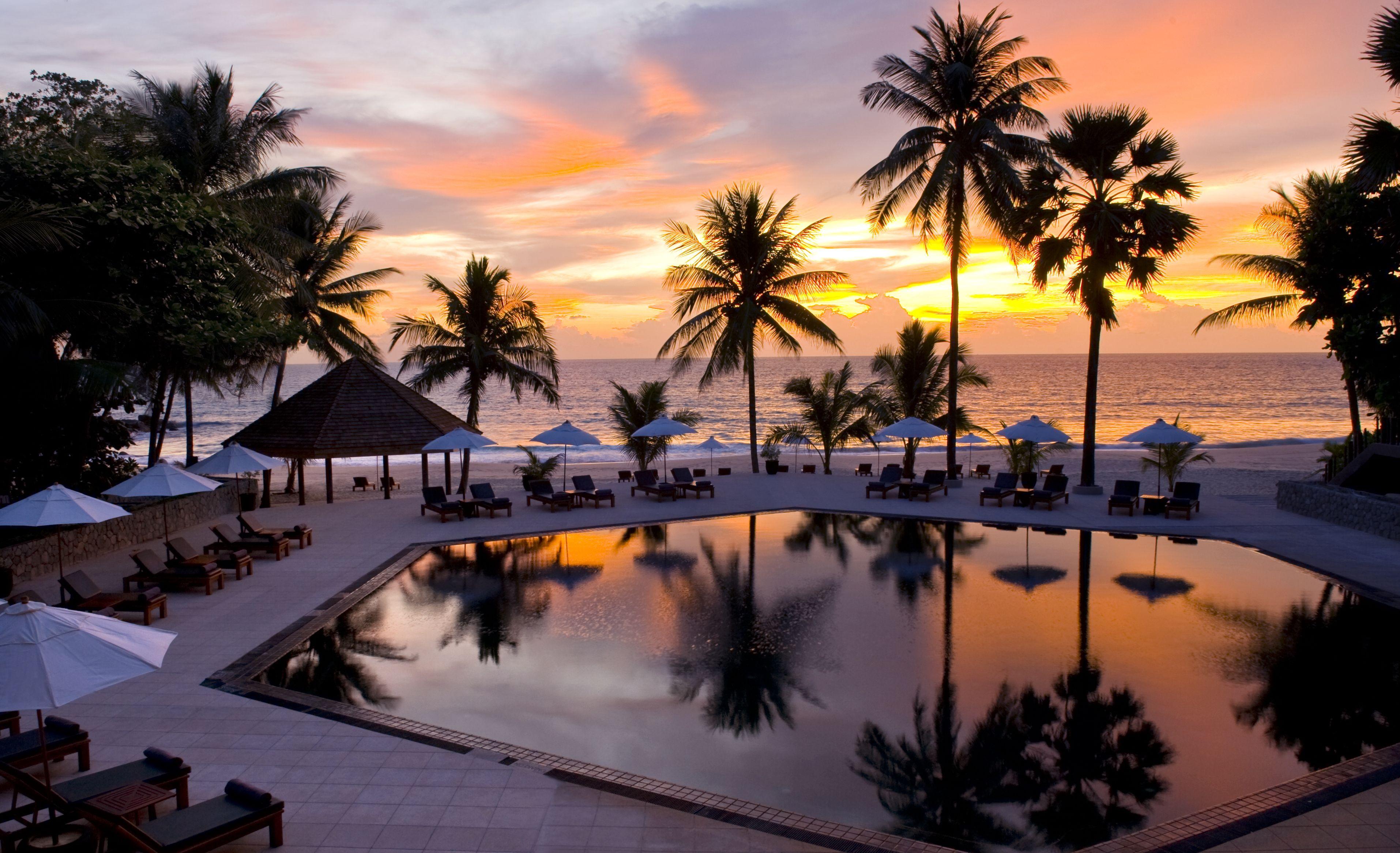Sunset At The Surin Sunset Pool Phuket Resort Luxury Beach Resorts Beach Resorts Phuket