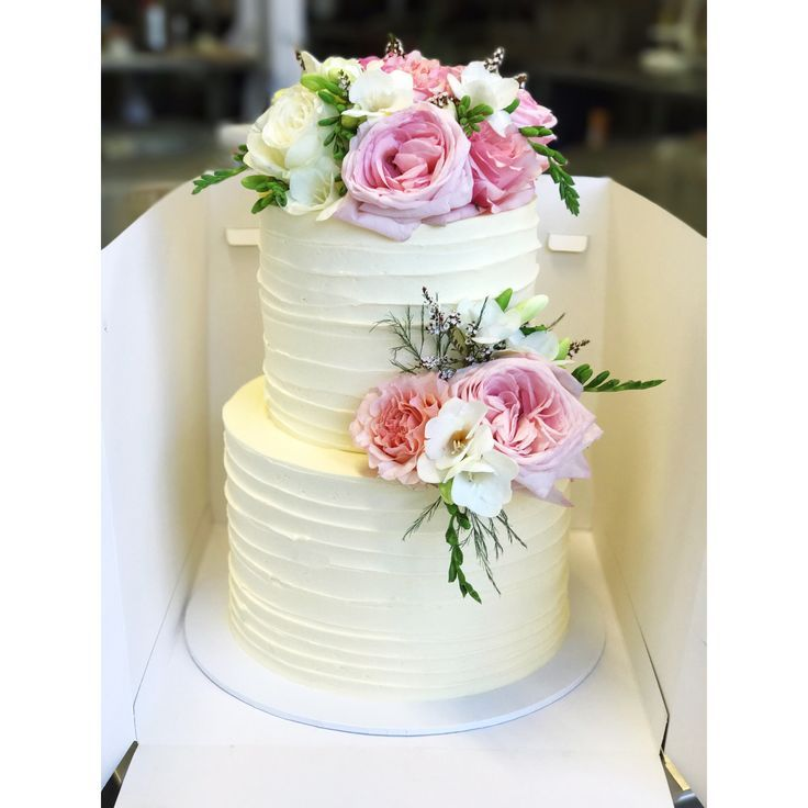 Two tier wedding cake with textured buttercream and fresh