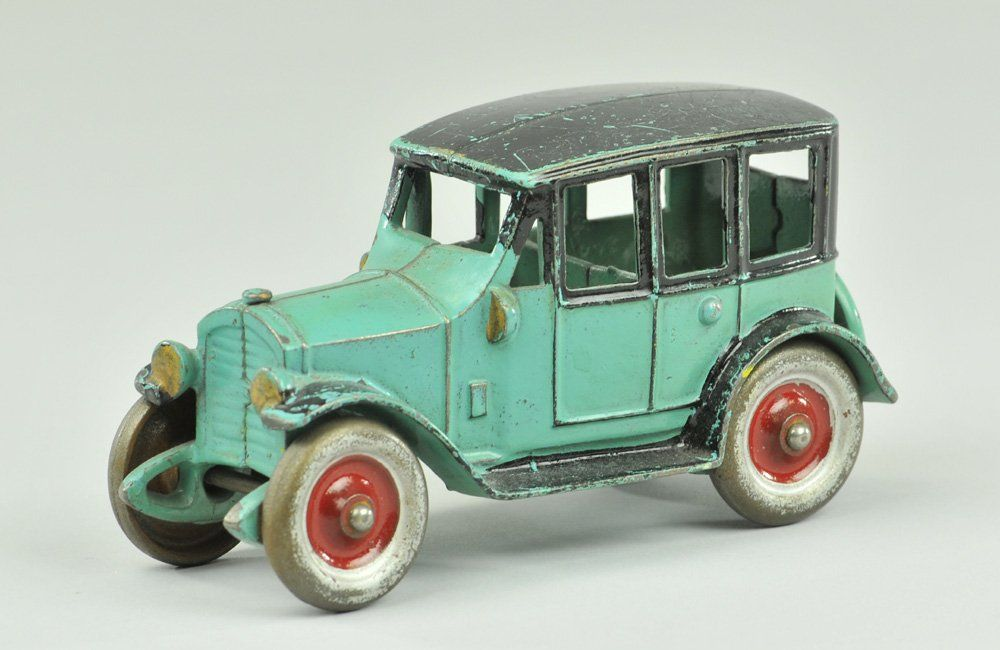 KENTON SEDAN  Cast iron, circa mid 1920's, painted in blue body, black roof, silver and red disc wheels, spare cast at trunk.