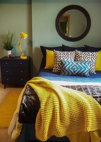 a modern navy and teal bedroom with bold pops of yellow by lindsay hoekstra west michigan. Black Bedroom Furniture Sets. Home Design Ideas
