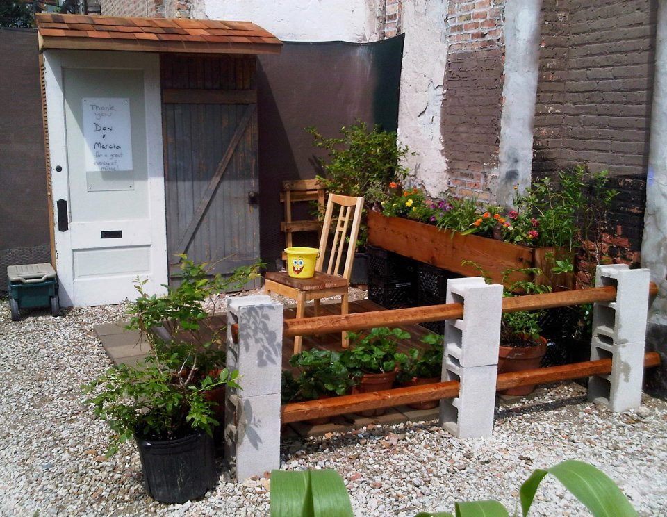 This is a great idea for a DIY fence. Cinder blocks and wood - simple and looks nice. This is from the Montrose Green Community Garden in Northcenter ...