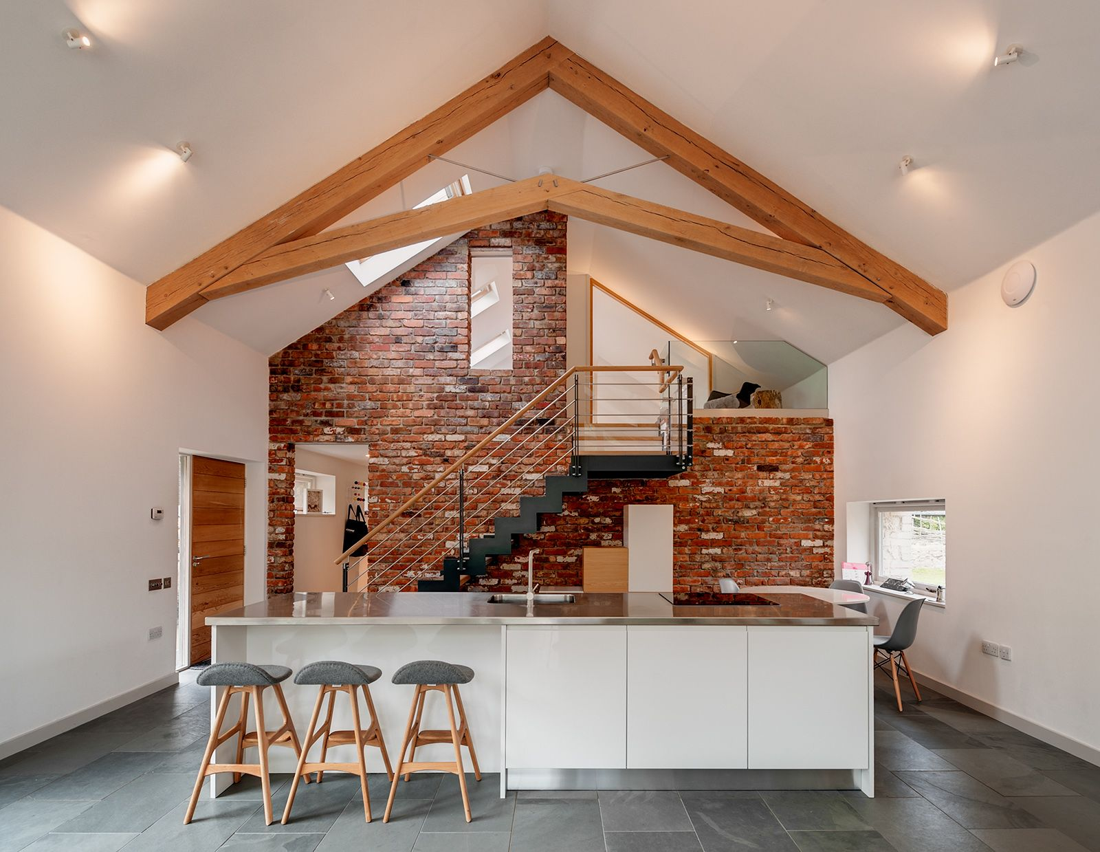 Barn renovation and conversion with green oak frame truss white