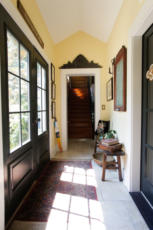 Black French Doors leading to backyard Rustic Interior Design