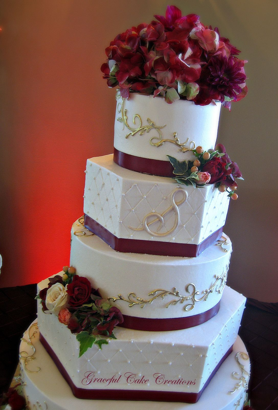 Elegant Ivory Buttercream Wedding Cake with Burgundy and