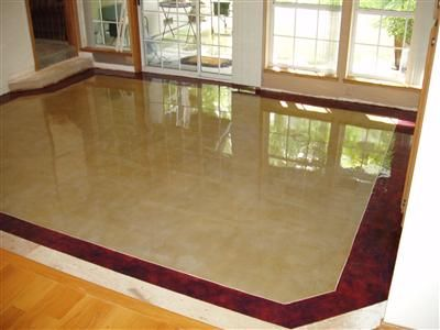 Concrete Floor Design Ideas white kitchen and dining room with wooden table and concrete floor Advanced Construction Modesto Ca A Colored And Polished Concrete Floor With A Red Border Around