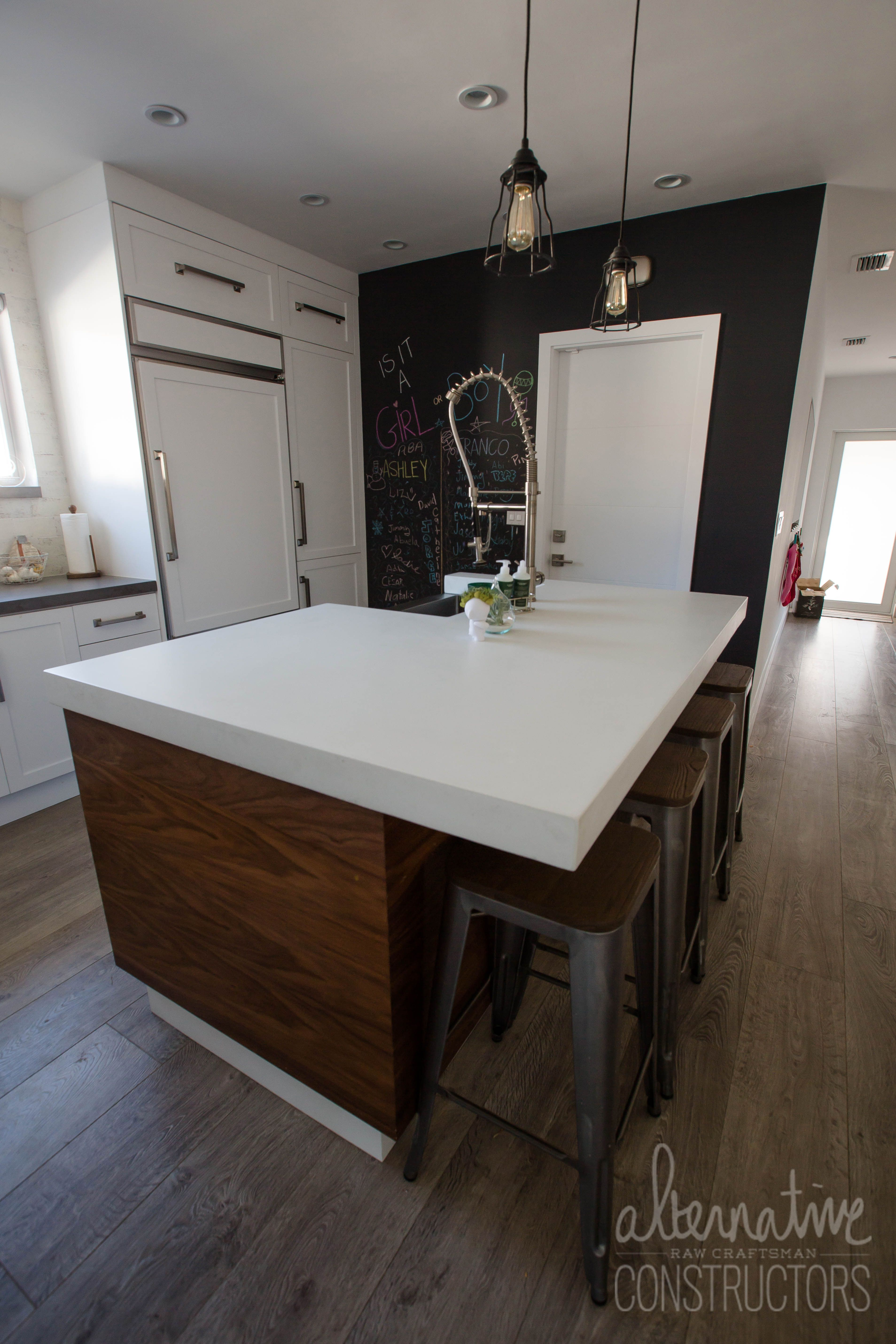 White concrete kitchen island countertop with hardwood side