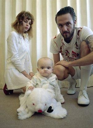 Watkin Tudor Jones with girlfriend Yolandi Visser and newly born daughter Sixteen