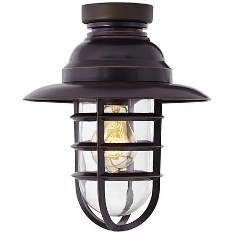 An oil-rubbed bronze metal ceiling fan light kit with included vintage style Edison bulb.