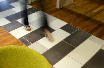 Cast Concrete Floor Tile - Interesting idea to completely alter the look of a wood flooring