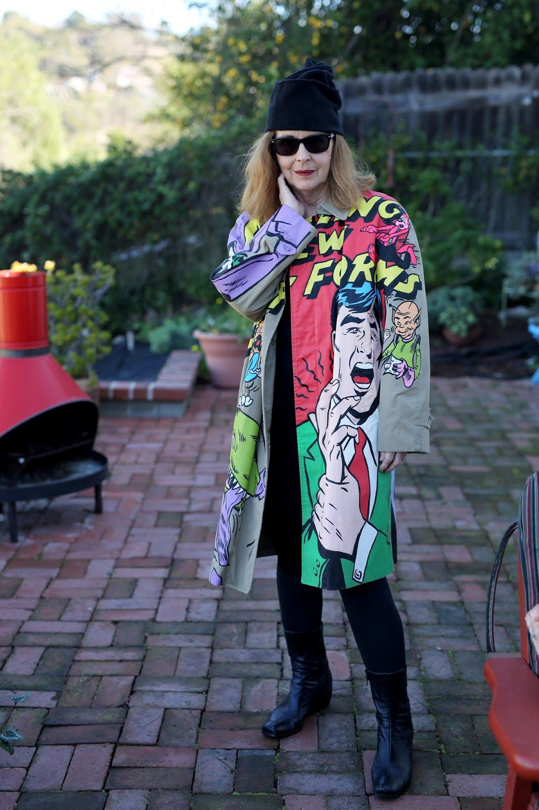 Painted raincoat by and worn by artist Suzan Pitt