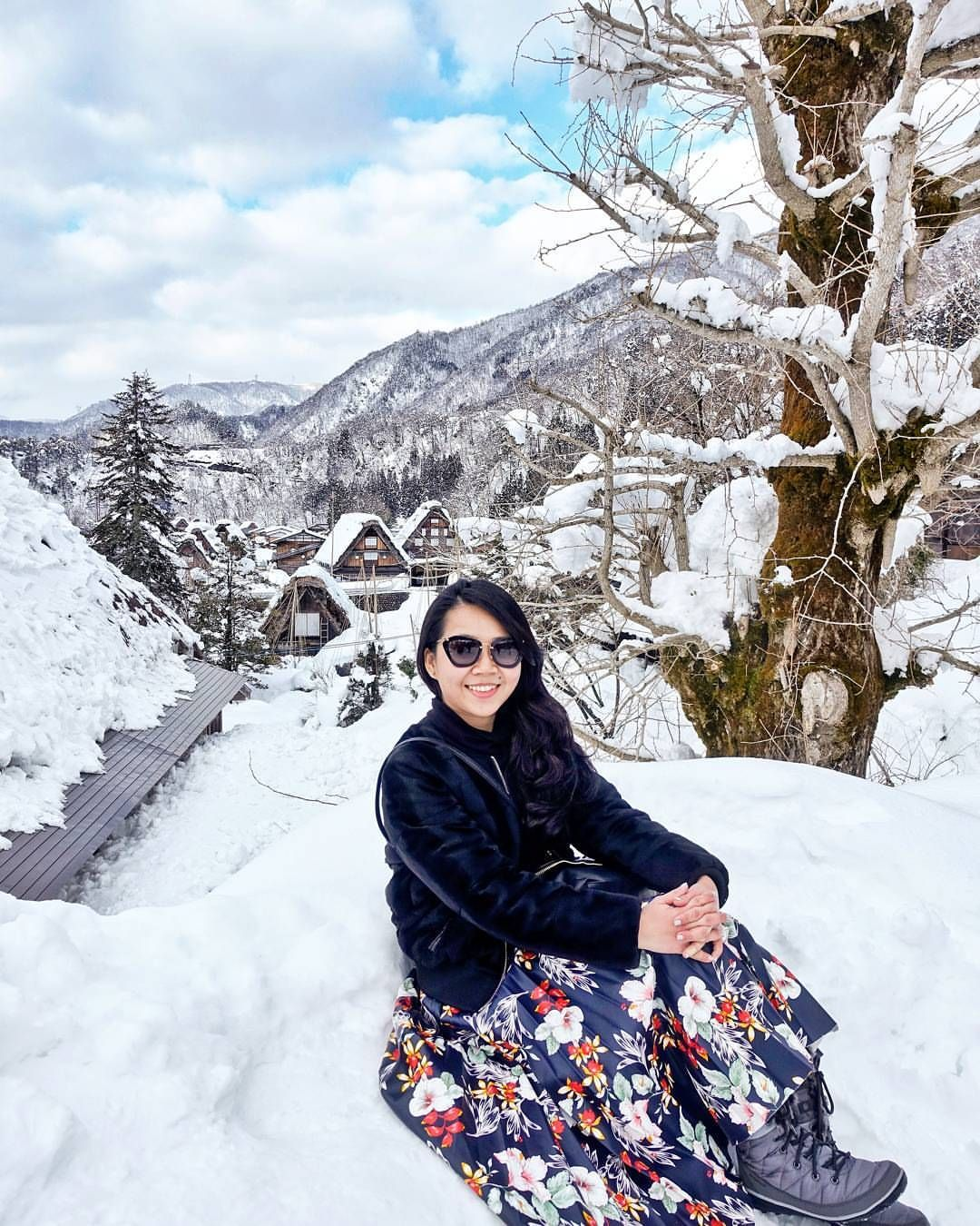 Best viewed in winter when everything is covered in pearly white fine snow. Shirakawa-go Village from the viewpoint, Ono District, Gifu Prefecture, Japan.  Instagram: @quennandher Miu Miu sunnies // TOPSHOP pleated floral skirt // H&M faux fur jacket