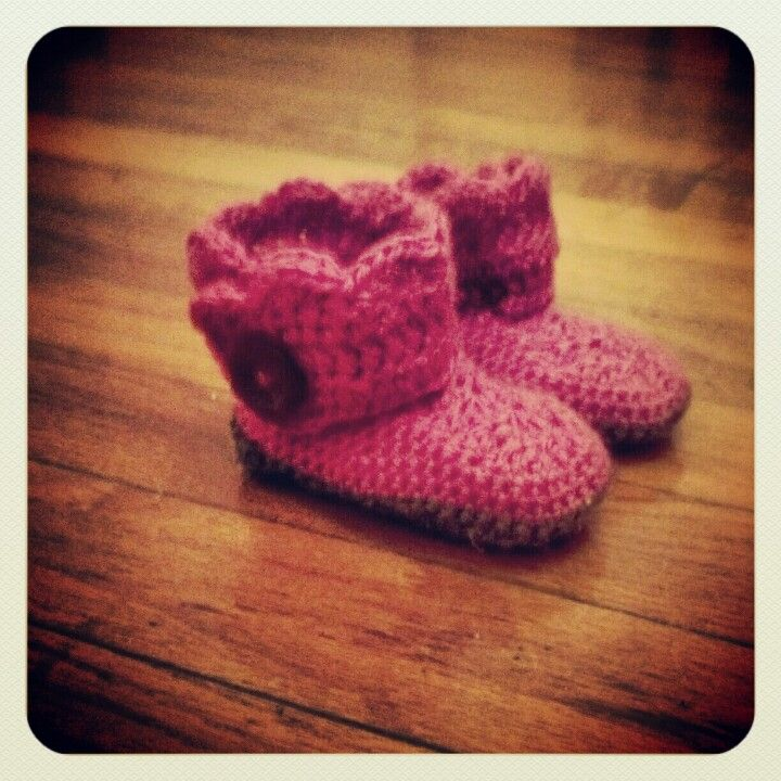 My first successful boot project, made from this awesome free pattern: http://imtopsyturvy.com/crochet-wrap-button-baby-boots-girls-boys/