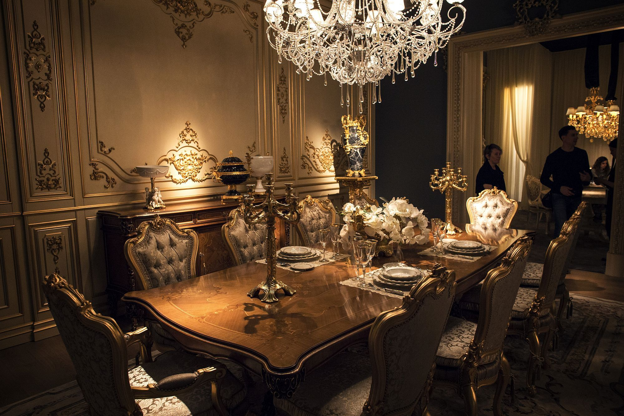 Opulent Victorian Style Dining Room In Gold And White With A Sparkling Chandelier