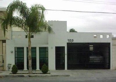 Fotos de fachadas de casas modernas de una planta con reja for Frentes de casas de una planta