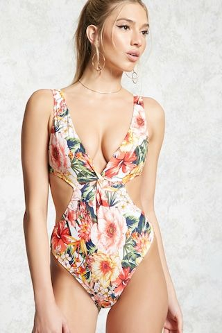918b4b0391 A one-piece swimsuit featuring an allover tropical floral print, a surplice  V-neck front, a cutout back, and a cheeky leg cut.
