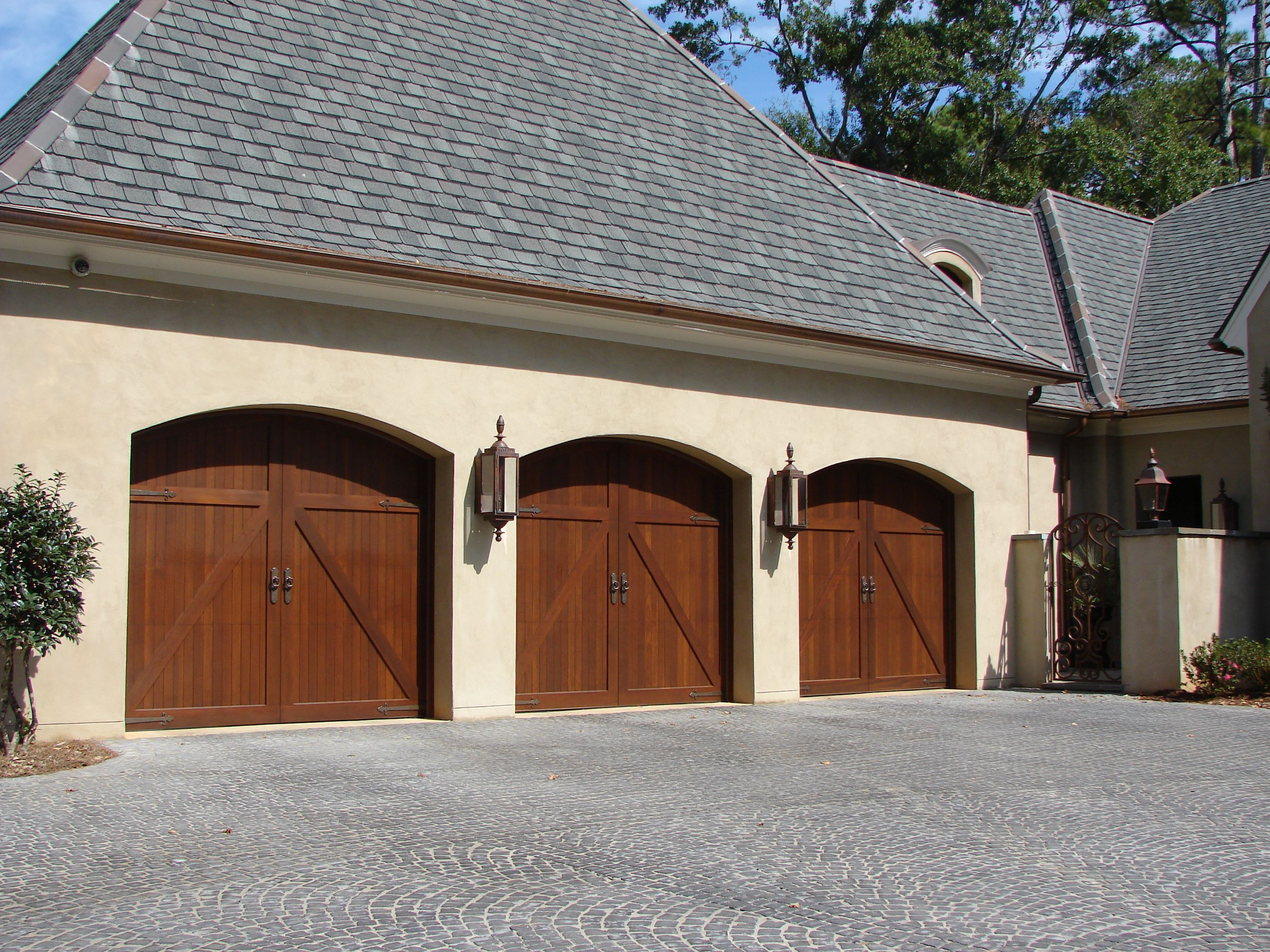 Garage Doors With Beautiful Stucco Exterior And Roof Pitch Home