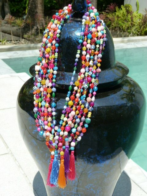 Long multi coloured knotted stones with tassles.