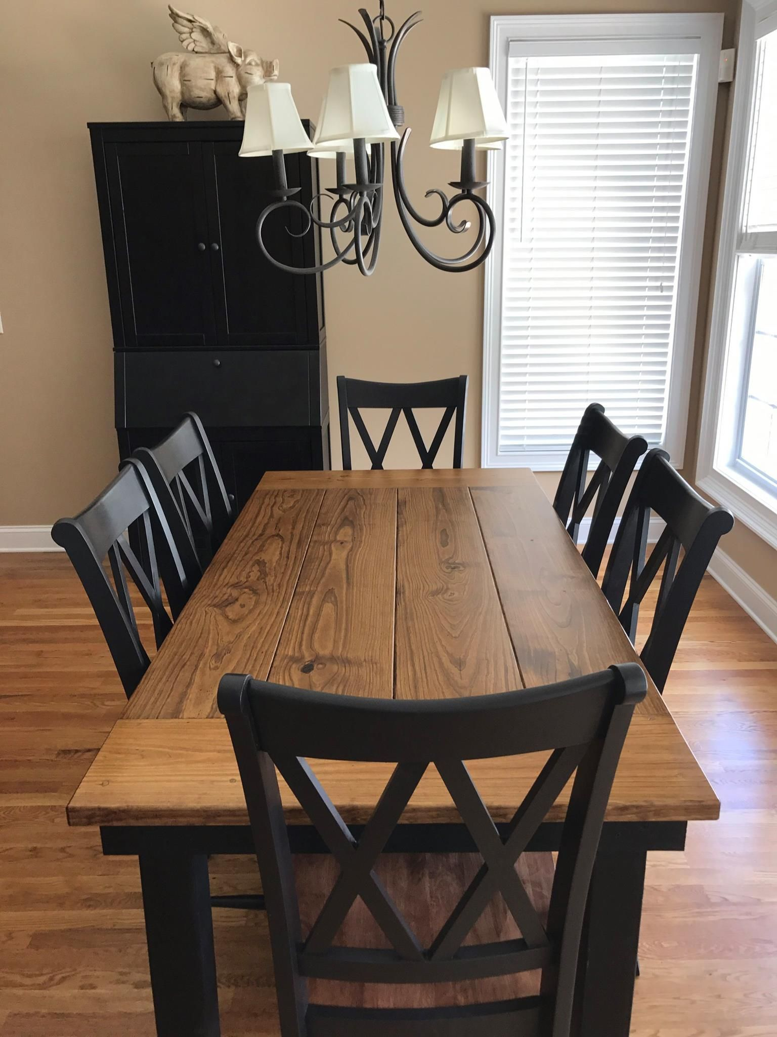 This 6 x 37 farmhouse table in early american stain on top and black painted base pairs stunningly with 6 double x back chairs solid wood furniture