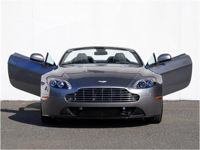 Here You Can See The Unique Swan Wing Doors That Rise At A 12 Degree Angle Designed Not Only For Its Impecca Aston Martin New Aston Martin Aston Martin Vantage