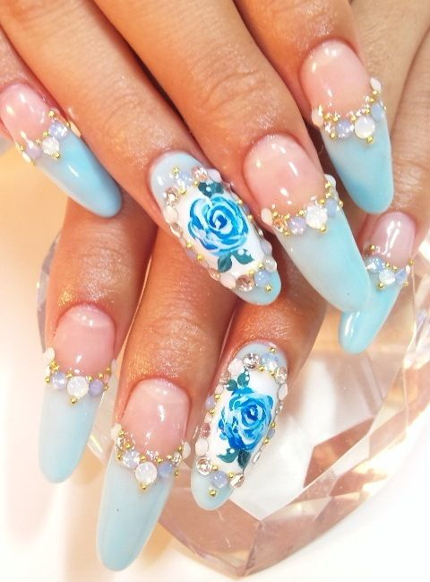 IMO these are the best nails I've ever seen. I love roses, I love baby blue as accents, and the jewels look so pretty. Want!