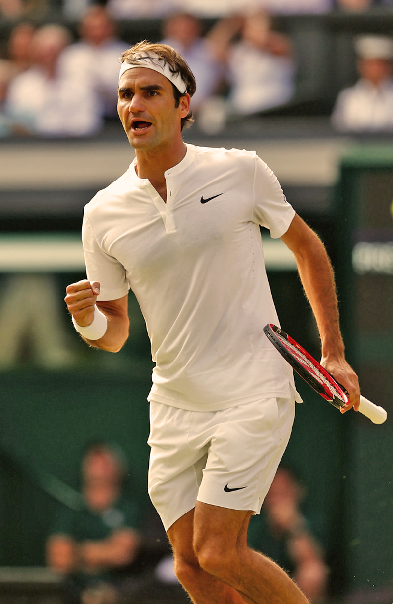 Roger Federer of Switzerland celebrates winning the first set in the Gentlemens Singles Semi Final match against Andy Murray of Great Britain during day eleven of the Wimbledon Lawn Tennis Championships at the All England Lawn Tennis and Croquet Club on July 10, 2015 in London, England.