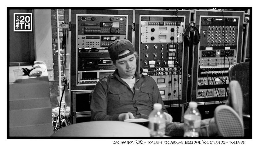 """Photo 301 of 365  Zac Hanson 2012 - Tonight Recording Sessions, 3CG Studios - Tulsa OK    Zac is rocking a backwards hat in this quiet moment in the studio while recording an album contender, the song """"Tonight"""". Zac is working on some kind of notes here, what is on his notebook page? (Be creative)    #Hanson #Hanson20th"""