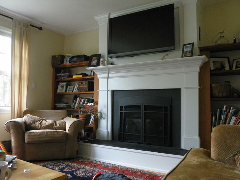 Comfortable Family Room With Big Armchairs A Mounted Flat Screen TV Above The Fireplace And