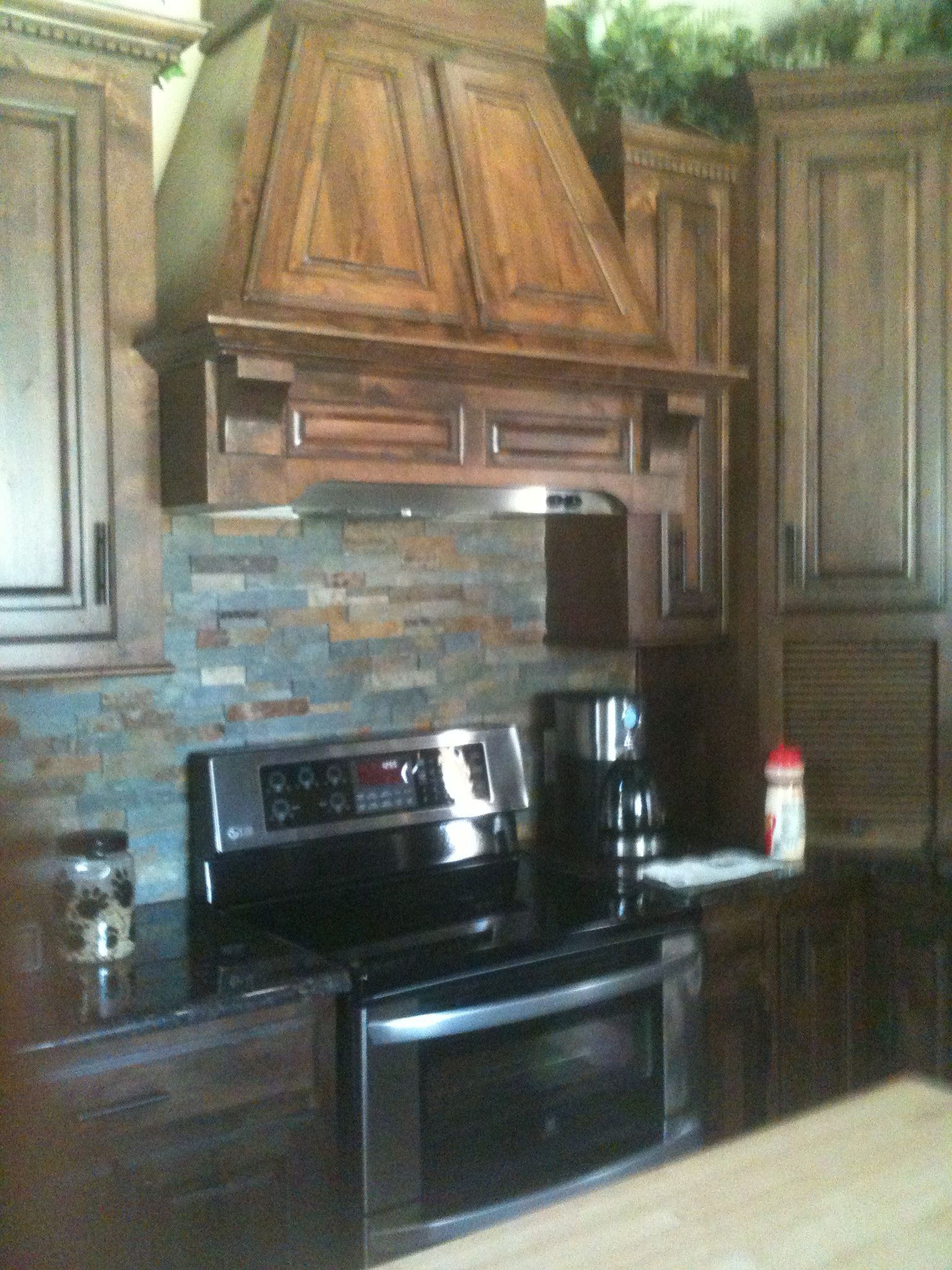 kitchen remodel stone backsplash and wood vent hood harper construction tx kitchen remodel on kitchen remodel vent hood id=78904