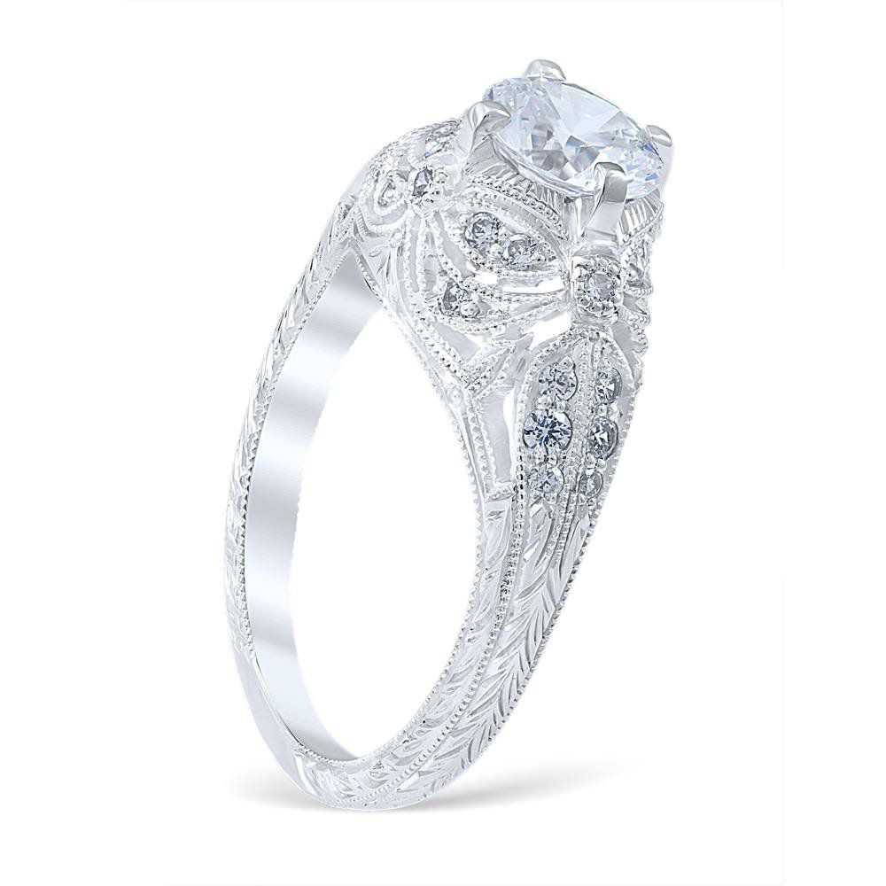 <p>Lincoln Drape engagement ring featuring a spectacular display of bead set diamonds, cascading filigree draperies, and subtle dragonfly detailing.</p> <p> </p> <p>MSRP 14K:  $3,715.00<br />MSRP 18K:  $4,345.00<br />MSRP Plat:  $5,175.00<br /><em>(Not including center diamond)</em></p> <p><br />Center Diamond Carat Range: 0.75-3.00ct.<br...