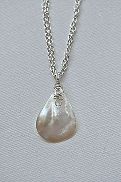 Wire wrapped shell pendant necklace jewelry creation pinterest wire wrapped shell pendant necklace aloadofball Gallery