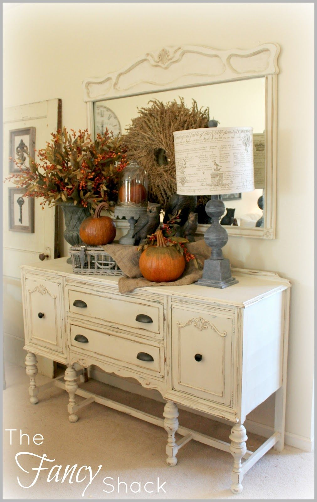 I like the old dresser, mirror, and the accessories but may be not so many in one spot. Editing the wreath on the mirror would be a good start.