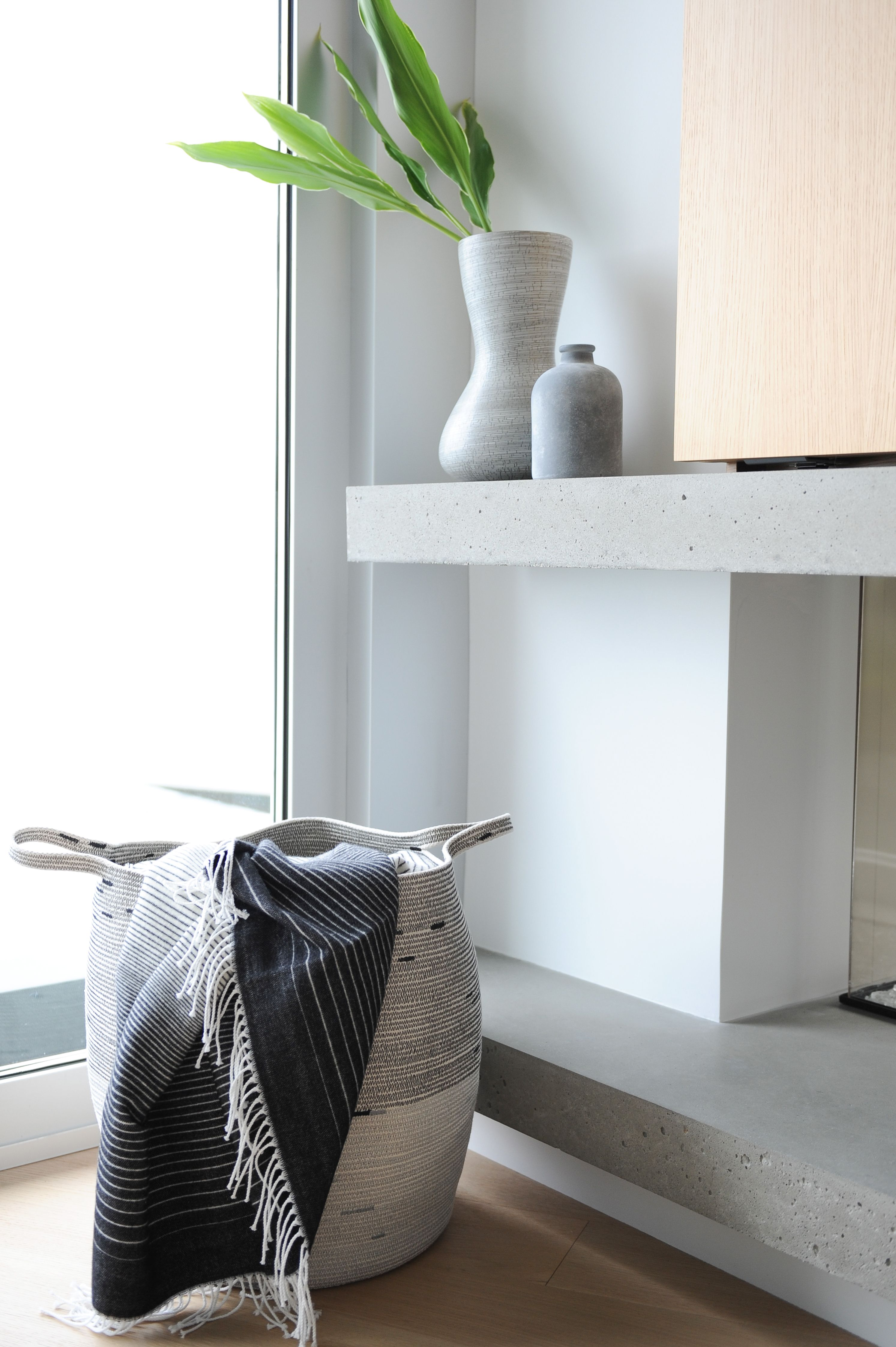 Accessorize with monochromatic vases and baskets. It greats a sense of completion.