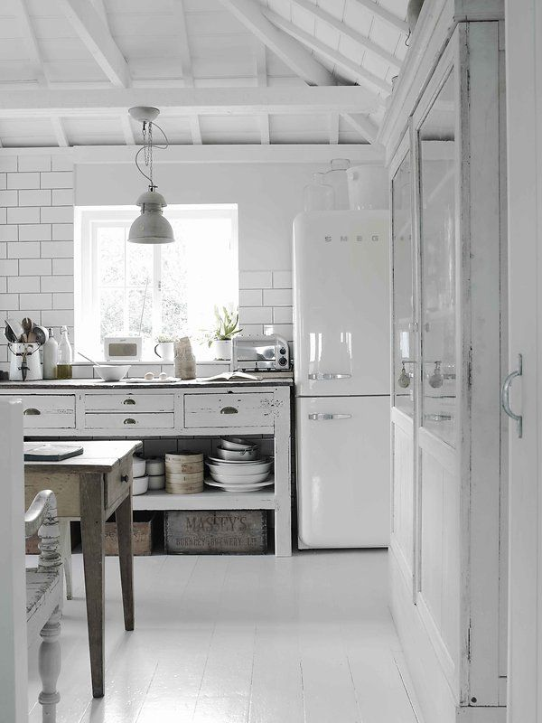 White Smeg Subway Tile With Dark Grout Wood Floors Painted A Lovely Shade Open Storage To Display Le Creuset Collection