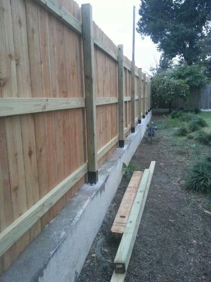 Took Out Old Fence Posts Were Embeded In Retaining Wall So Had To Mount New Posts On Top Of Wall Backyard Fences Fence Decor Concrete Fence
