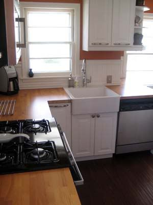 White cabinets with beech butcher block counter top ikea susie noland heart of the home - Ikea beech kitchen cabinets ...