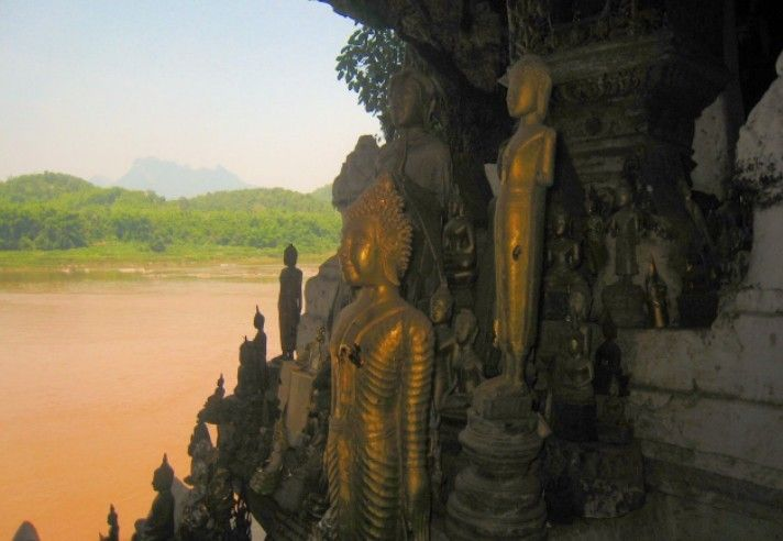 Explore the sacred Pak Ou Caves on the Mekong River in Loas