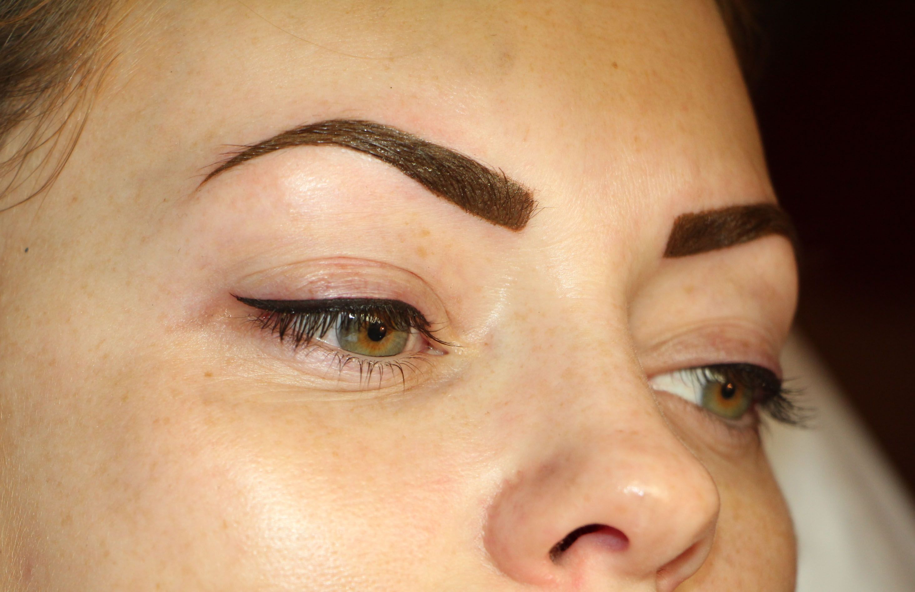 Powdered brows and top eyeliner permanent makeup