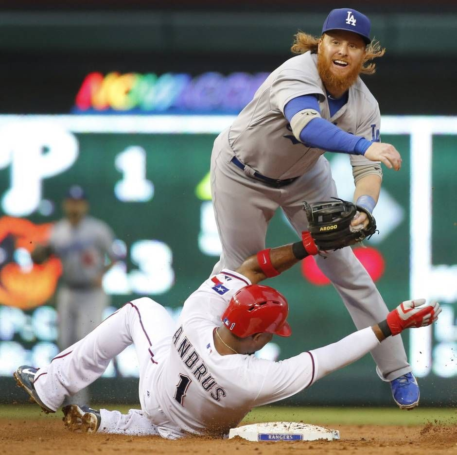 Texas Rangers shortstop Elvis Andrus (1) goes in hard at second base as Los Angeles Dodgers creepy third baseman Justin Turner (10) turns the pivot at second base in the third inning during the Los Angeles Dodgers vs. the Texas Rangers major league baseball game at Globe Life Park in Arlington, Texas, on Tuesday, June 16, 2015. (Louis DeLuca/The Dallas Morning News)