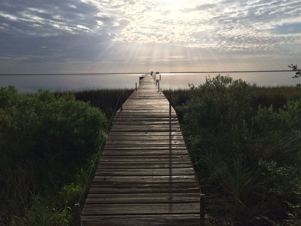 Amelia by the Bay is a vacation rental in Cape San Blas, FL. with a 500' dock, Kayaks, Paddle boards and fishing. , Amelia by The Bay, Best of the Bay and Beach!