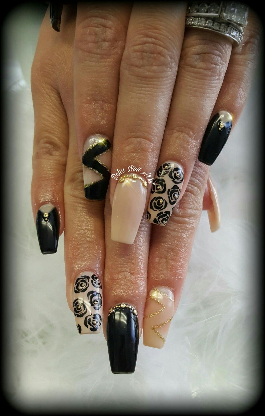 Black, nude and gold acrylic nails. Coffin shape. Free handed ...