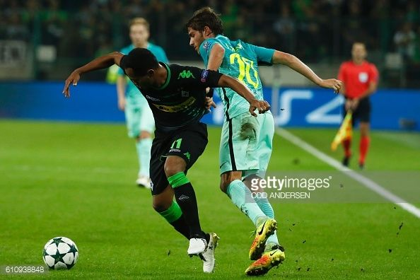 Moenchengladbach's Brazilian forward Raffael has his short pulled by Barcelona's midfielder Sergi Roberto during the UEFA Champions League firstleg...