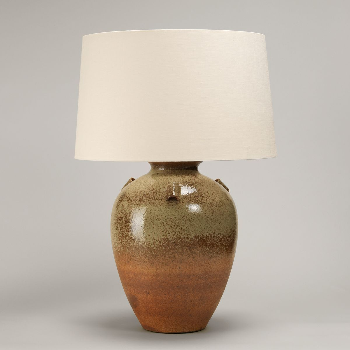 The Barton Vase Table Lamp with natural tones and the texture of stoneware with a terracotta wash is complemented by the sheen of the speckled glaze decorating the top of the vase. The small handles add character. #countrylife #décor #designinspiration #dreamhouse #homedecor #homeimprovement #homeliving #inspiration #interiordesign #lifestyle #luxury #luxuryhomes #luxurylifestyle