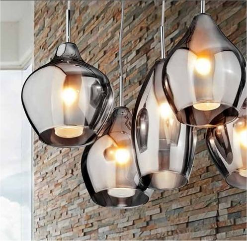 Our Favourite Five Light Cluster Pendant Uses An Assortment Of Different Shaped Iridescent Smoked Glass Shades With A White Diffuser Inside