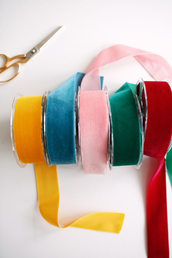 Using brightly coloured ribbon and white paper gives a present a sophisticated look. Velvet Ribbon – RH Signature Co.