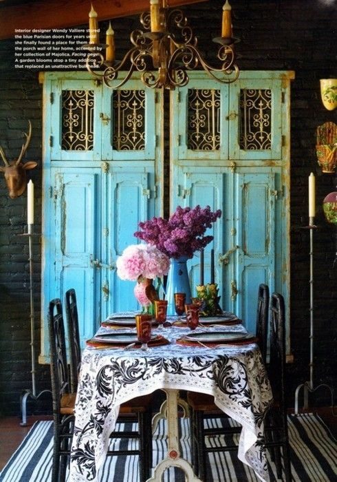 turquoise chest behind the dining room table