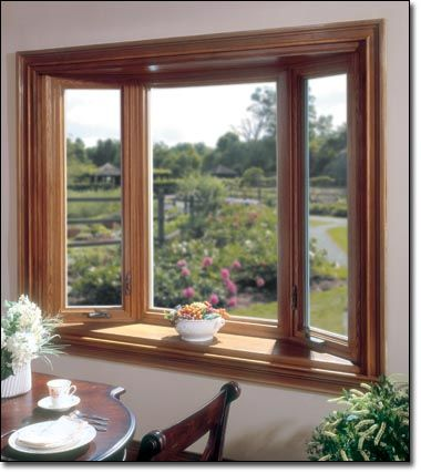 Bay windows with stained trim bay windows charlotte for Picture window replacement ideas