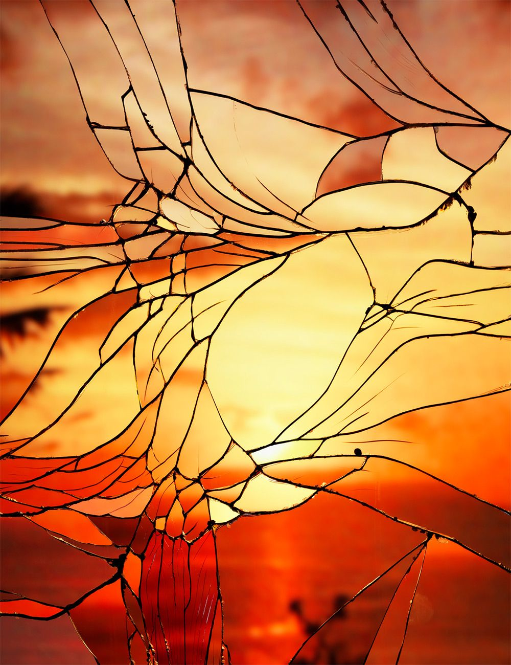 Sunsets look like stained glass art when captured through shattered ...